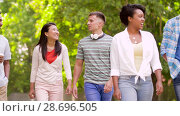 Купить «international friends with coffee walking in park», видеоролик № 28696505, снято 25 июня 2018 г. (c) Syda Productions / Фотобанк Лори