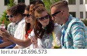 Купить «friends with smartphones and tablet pc in city», видеоролик № 28696573, снято 25 июня 2018 г. (c) Syda Productions / Фотобанк Лори