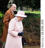 Купить «Queen Elizabeth II visits West Newton Church on the Sandringham Estate Featuring: Queen Elizabeth II, Prince Phillip Where: Kings Lynn, United Kingdom When: 01 Feb 2015 Credit: Ward/WENN.com», фото № 28698309, снято 1 февраля 2015 г. (c) age Fotostock / Фотобанк Лори