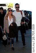 Купить «LeAnn Rimes and her husband Eddie Cibrian at Los Angeles International Airport (LAX) Featuring: LeAnn Rimes, Eddie Cibrian Where: Los Angeles, California...», фото № 28701009, снято 28 декабря 2016 г. (c) age Fotostock / Фотобанк Лори