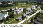 Купить «Panoramic aerial view of of Pokrovsky monastery in Suzdal , Russia», видеоролик № 28702689, снято 28 июня 2018 г. (c) Яков Филимонов / Фотобанк Лори