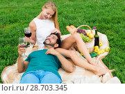 Купить «Boyfiend is relaxing on the lap of female», фото № 28703345, снято 10 августа 2017 г. (c) Яков Филимонов / Фотобанк Лори