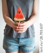 Купить «watermelon popsicle in female hands», фото № 28703637, снято 7 июля 2018 г. (c) Ольга Сергеева / Фотобанк Лори