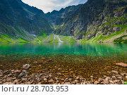 Купить «a cold picturesque mountain lake Czarny Staw in the high Tatra mountains in Poland», фото № 28703953, снято 18 августа 2017 г. (c) Константин Лабунский / Фотобанк Лори