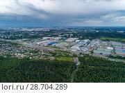 Купить «Aerial view of wheat fields, meadow, forest andindustrial warehouses in rural Russia.», фото № 28704289, снято 11 июня 2018 г. (c) Андрей Радченко / Фотобанк Лори