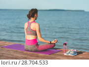 Купить «Sporty young girl in the morning on seashore, practicing yoga. Woman do gymnastics outdoor. Health and Yoga Concept», фото № 28704533, снято 23 июня 2018 г. (c) Сергей Тимофеев / Фотобанк Лори