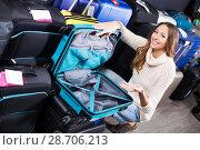 Купить «Woman selecting handy trunk», фото № 28706213, снято 16 августа 2018 г. (c) Яков Филимонов / Фотобанк Лори