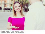Купить «Young female is flirting with guy», фото № 28706289, снято 18 октября 2017 г. (c) Яков Филимонов / Фотобанк Лори