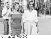 Купить «Young women are walking and stranger man is want acquaintance with them», фото № 28706305, снято 18 октября 2017 г. (c) Яков Филимонов / Фотобанк Лори