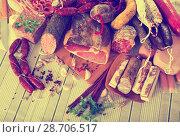 Купить «Variety of meats on table», фото № 28706517, снято 15 декабря 2018 г. (c) Яков Филимонов / Фотобанк Лори