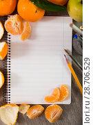 Купить «Notebook surrounded by fruit», фото № 28706529, снято 10 декабря 2018 г. (c) Яков Филимонов / Фотобанк Лори