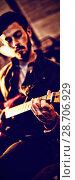 Купить «Young man playing guitar », фото № 28706929, снято 26 июня 2019 г. (c) Wavebreak Media / Фотобанк Лори