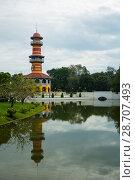Купить «Thasana tower in Bang Pa-In Palace Thailand», фото № 28707493, снято 24 ноября 2013 г. (c) Александр Романов / Фотобанк Лори
