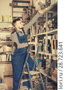 Купить «Adult male worker looking through sanitary drain pipes», фото № 28723641, снято 15 марта 2017 г. (c) Яков Филимонов / Фотобанк Лори