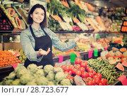 Купить «Female shopping assistant demonstrating assortment of grocery shop», фото № 28723677, снято 18 марта 2017 г. (c) Яков Филимонов / Фотобанк Лори