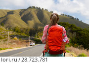 Купить «woman with backpack traveling over big sur hills», фото № 28723781, снято 25 июля 2015 г. (c) Syda Productions / Фотобанк Лори