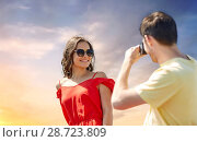 happy couple with camera photographing. Стоковое фото, фотограф Syda Productions / Фотобанк Лори