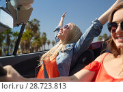 Купить «happy young women driving in car over venice beach», фото № 28723813, снято 28 мая 2016 г. (c) Syda Productions / Фотобанк Лори