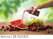 Купить «hand pouring fruit juice from bottle to glass», фото № 28723821, снято 5 августа 2016 г. (c) Syda Productions / Фотобанк Лори