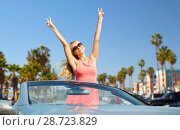 Купить «happy woman in convertible car over venice beach», фото № 28723829, снято 17 августа 2017 г. (c) Syda Productions / Фотобанк Лори