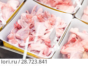 Купить «poultry meat in bowls at grocery stall», фото № 28723841, снято 2 ноября 2016 г. (c) Syda Productions / Фотобанк Лори