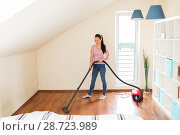 Купить «woman or housewife with vacuum cleaner at home», фото № 28723989, снято 29 апреля 2018 г. (c) Syda Productions / Фотобанк Лори