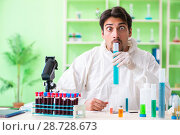 Купить «Chemist working in the lab on new experiment», фото № 28728673, снято 16 мая 2018 г. (c) Elnur / Фотобанк Лори