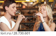 Купить «happy women drinking wine at bar or restaurant», видеоролик № 28730601, снято 4 июля 2018 г. (c) Syda Productions / Фотобанк Лори