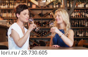 Купить «happy women drinking wine at bar or restaurant», видеоролик № 28730605, снято 4 июля 2018 г. (c) Syda Productions / Фотобанк Лори