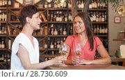 Купить «happy women drinking wine at bar or restaurant», видеоролик № 28730609, снято 6 июля 2018 г. (c) Syda Productions / Фотобанк Лори