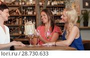 Купить «women giving present to friend at wine bar», видеоролик № 28730633, снято 4 июля 2018 г. (c) Syda Productions / Фотобанк Лори