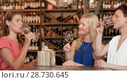 Купить «women with gift drinking wine at bar or restaurant», видеоролик № 28730645, снято 4 июля 2018 г. (c) Syda Productions / Фотобанк Лори