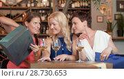 Купить «women with shopping bags at wine bar or restaurant», видеоролик № 28730653, снято 4 июля 2018 г. (c) Syda Productions / Фотобанк Лори