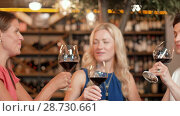 Купить «happy women drinking red wine at bar or restaurant», видеоролик № 28730661, снято 4 июля 2018 г. (c) Syda Productions / Фотобанк Лори