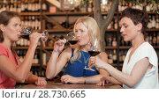 Купить «happy women drinking red wine at bar or restaurant», видеоролик № 28730665, снято 4 июля 2018 г. (c) Syda Productions / Фотобанк Лори