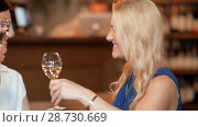 Купить «happy women drinking wine at bar or restaurant», видеоролик № 28730669, снято 4 июля 2018 г. (c) Syda Productions / Фотобанк Лори