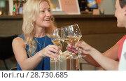 Купить «women giving present to friend at wine bar», видеоролик № 28730685, снято 4 июля 2018 г. (c) Syda Productions / Фотобанк Лори