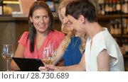 Купить «women with tablet pc at bar wine or restaurant», видеоролик № 28730689, снято 4 июля 2018 г. (c) Syda Productions / Фотобанк Лори