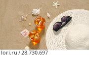 Купить «cocktails, sun hat and sunglasses on beach sand», видеоролик № 28730697, снято 5 июля 2018 г. (c) Syda Productions / Фотобанк Лори