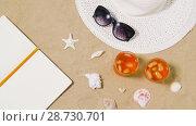 Купить «notebook, cocktails, hat and shades on beach sand», видеоролик № 28730701, снято 8 июля 2018 г. (c) Syda Productions / Фотобанк Лори