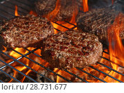 Beef burger for hamburger on barbecue flame grill. Стоковое фото, фотограф Anton Eine / Фотобанк Лори