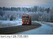 Купить «Dusktime winter road landscape with Red Sisu Polar logging truck on a cold frosty evening in Salo, Finland - January 21, 2018.», фото № 28735081, снято 21 января 2018 г. (c) age Fotostock / Фотобанк Лори