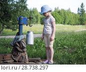 Купить «A small child is gaining water through a water pump in the village», фото № 28738297, снято 17 июля 2018 г. (c) Ирина Козорог / Фотобанк Лори