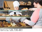 Купить «Cook selling pastry to customer», фото № 28738481, снято 22 июля 2018 г. (c) Яков Филимонов / Фотобанк Лори
