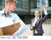 Купить «Businesswoman is wishing good luck to worker», фото № 28738589, снято 15 июля 2017 г. (c) Яков Филимонов / Фотобанк Лори