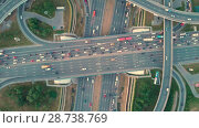 Купить «Aerial top view of road junction in Moscow from above, automobile traffic and jam of many cars, transportation concept», видеоролик № 28738769, снято 9 июля 2018 г. (c) Mikhail Starodubov / Фотобанк Лори