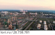 Купить «Oil refinery plant industry, Refinery factory, oil storage tank and pipeline steel with sunrise and cloudy sky background, Russia», видеоролик № 28738781, снято 10 июля 2018 г. (c) Mikhail Starodubov / Фотобанк Лори