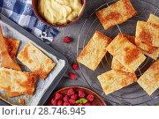 Купить «portions of puff pastry on a baking sheet», фото № 28746945, снято 4 июля 2018 г. (c) Oksana Zh / Фотобанк Лори