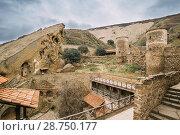 Купить «Sagarejo Municipality, Kakheti Region, Georgia. Ancient Rock-hewn Georgian Orthodox David Gareja Monastery Complex. Monastery Is Located Is Southeast Of Tbilisi. 6th Ñ.Hundreds Of Cells, Churches.», фото № 28750177, снято 23 октября 2016 г. (c) easy Fotostock / Фотобанк Лори