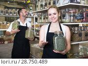 Купить «man and woman sellers posing with banks of dried herbs in store», фото № 28750489, снято 16 июля 2018 г. (c) Татьяна Яцевич / Фотобанк Лори